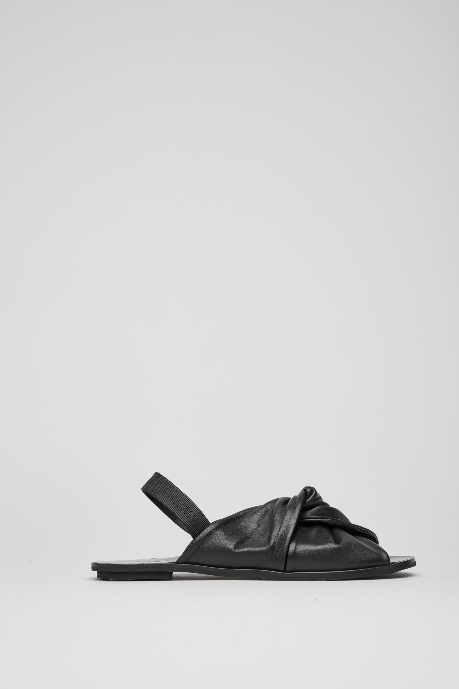 e728cd7b05a34 COS – knotted leather sandals.